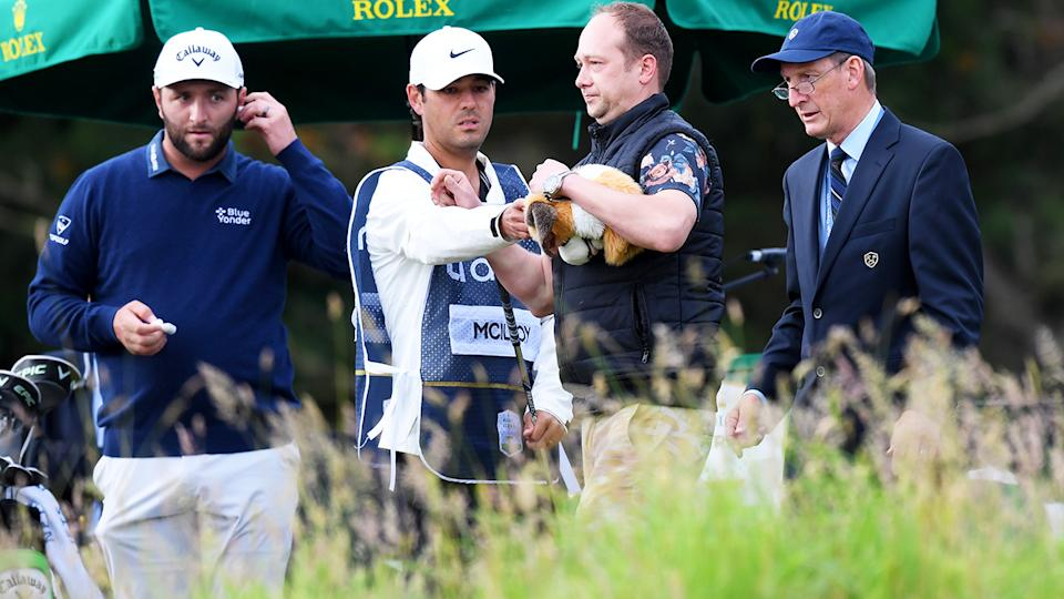 The spectator, pictured here being removed by security at the Scottish Open.