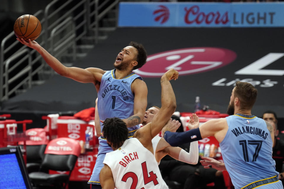 Memphis Grizzlies forward Kyle Anderson (1) puts up a shot over Toronto Raptors center Khem Birch (24) during the first half of an NBA basketball game Saturday, May 8, 2021, in Tampa, Fla. (AP Photo/Chris O'Meara)
