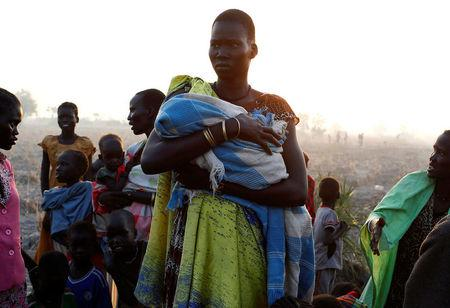 A woman waits to be registered prior to a food distribution carried out by the United Nations World Food Programme (WFP) in Thonyor, Leer state, South Sudan