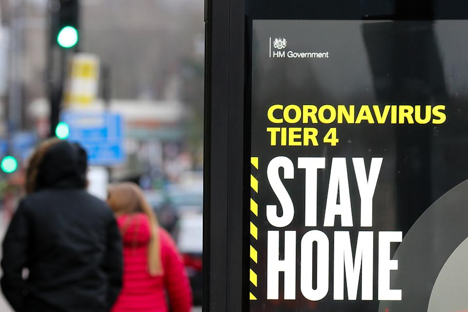 A 'Stay Home' sign seen in London as many parts of the UK are now in Tier 4 COVID-19 restrictions. The UK has recorded its highest daily rise in coronavirus cases since the pandemic began with 41,385 positive tests. Prime Minister Boris Johnson hasn't ruled out a national lockdown in the New Year. (Photo by Dinendra Haria / SOPA Images/Sipa USA)