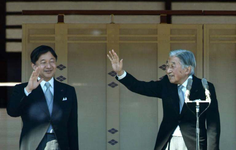 Emperor Akihito (R) and Crown Prince Naruhito at the royal family's New Year greeting to well-wishers at the Imperial Palace in Tokyo