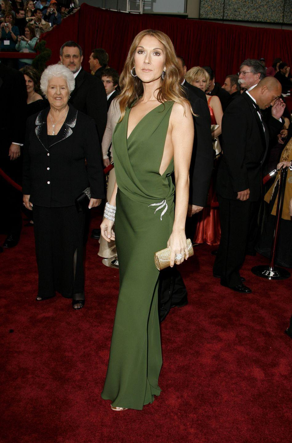 <p>A goddess in green, Celine turned heads on the red carpet wearing a deep-V wrap dress. She tastefully mixed metals in her accessories, with silver jewelry and a gold clutch.</p>