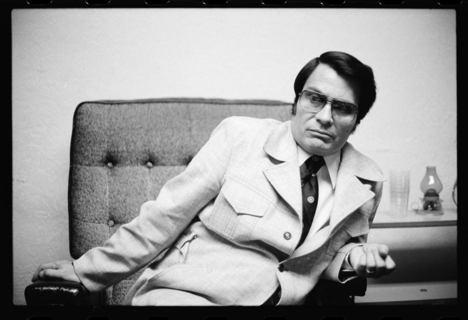 Portrait of American cult leader and founder of the People's Temple (formally known as the Peoples Temple of the Disciples of Christ) Jim Jones (1931 - 1978) as he poses in his office, San Francisco, California, July 1976.