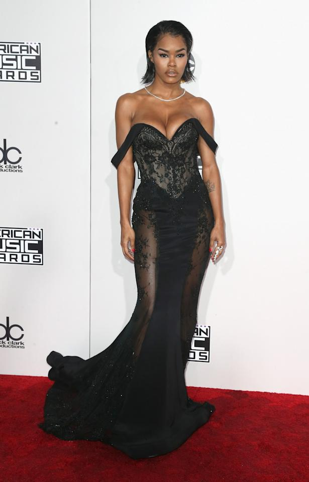 <p>Teyana Taylor sure didn't fade into the background wearing a black bustier gown with sheer lace cutouts. <em>(Photo: Getty Images)</em> </p>