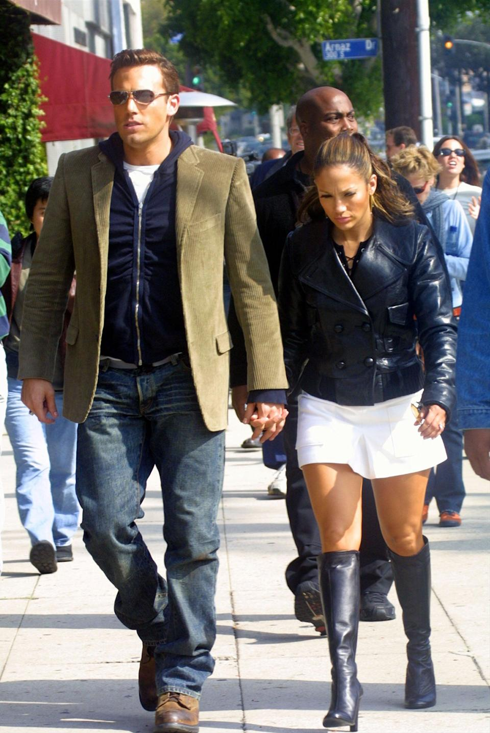 <p>The zip-up hoodie under the blazer is classic early 2000s, as are J.Lo's knee-high boots and mini combo on a walk in LA in October 2002.</p>