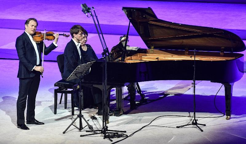 French solo violinist Renaud Capucon performs with pianists during the music carnival (AFP Photo/FAYEZ NURELDINE)