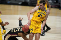 Michigan guard Franz Wagner (21) fights for a loose ball with Florida State guard M.J. Walker (23) during the second half of a Sweet 16 game in the NCAA men's college basketball tournament at Bankers Life Fieldhouse, Sunday, March 28, 2021, in Indianapolis. (AP Photo/Jeff Roberson)