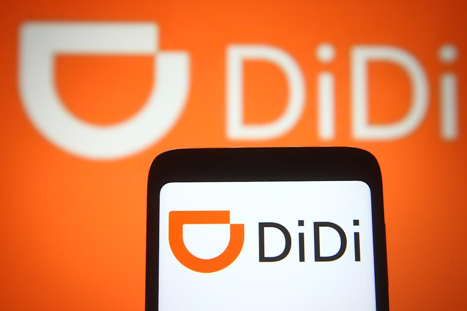 UKRAINE - 2021/03/30: In this photo illustration the DiDi (Didi Chuxing Technology Co.) logo of a Chinese transport company is seen on a smartphone and a pc screen. (Photo Illustration by Pavlo Gonchar/SOPA Images/LightRocket via Getty Images)