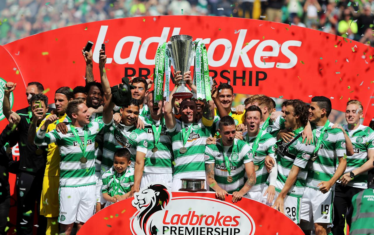 "FILE PHOTO: Football Soccer - Celtic v Motherwell - Ladbrokes Scottish Premiership - Celtic Park - 15/5/16.  Celtic's Scott Brown celebrates with the trophy and team mates after the game. Action Images via REUTERS/Russell Cheyne/Livepic/File Photo   EDITORIAL USE ONLY. No use with unauthorized audio, video, data, fixture lists, club/league logos or ""live"" services. Online in-match use limited to 45 images, no video emulation. No use in betting, games or single club/league/player publications.  Please contact your account representative for further details."