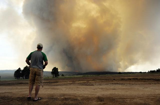 COLORADO SPRINGS, CO - JUNE 12: Shad Dohl, of Colorado Springs watches as smoke rises into the air from the Black Forest Fire June 12, 2013 near Colorado Springs, Colorado. The fire has reportedly burned 80 to 100 homes and has charred at least 8,000 acres. (Photo by Chris Schneider/Getty Images)