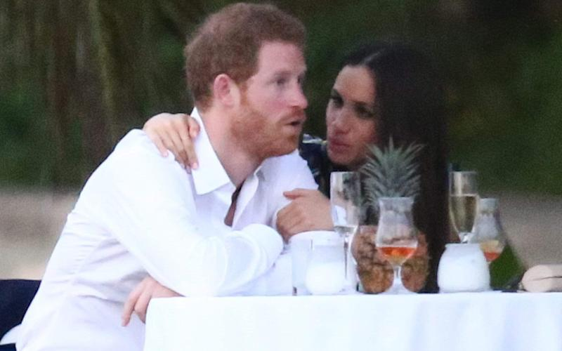Prince Harry and his girlfriend Meghan Markle pictured at a friend's wedding near Miami, Florida - Credit: 922