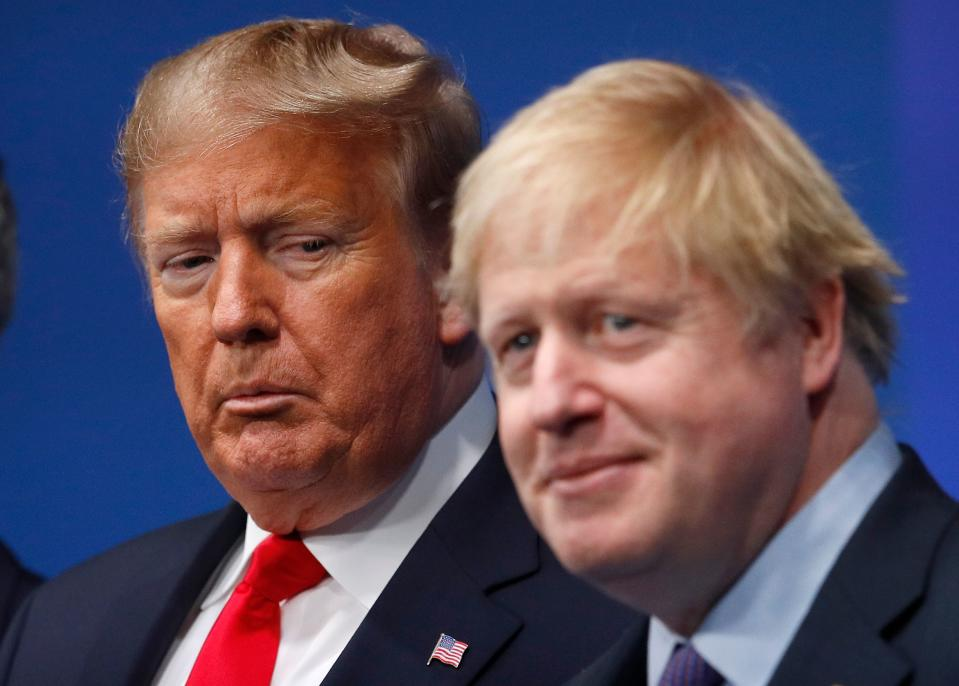 TOPSHOT - Britain's Prime Minister Boris Johnson (R) welcomes US President Donald Trump (L) to the NATO summit at the Grove hotel in Watford, northeast of London on December 4, 2019. (Photo by PETER NICHOLLS / various sources / AFP) (Photo by PETER NICHOLLS/AFP via Getty Images)