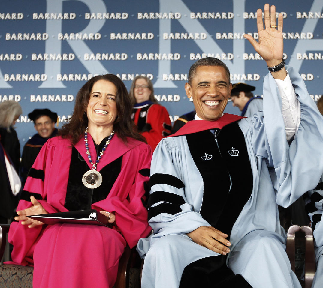 President Barack Obama, accompanied by Barnard College President Debora L. Spar, acknowledges applause as they take their seat before the president gave a commence address at Barnard College, Monday, May 14, 2012, in New York. Sitting with Obama is , left, President, . (AP Photo/Pablo Martinez Monsivais)