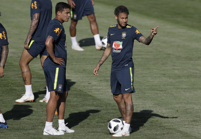 Brazil's Neymar, right, talks with teammate Thiago Silva during a training session in Sochi, Russia, Thursday, June 14, 2018. Brazil will face Switzerland on June 17 in the group E for the soccer World Cup. (AP Photo/Andre Penner)