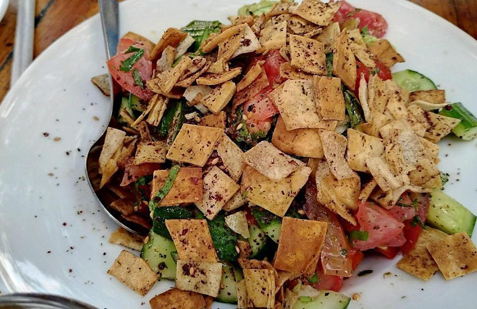 """<p>If you have any leftover pita bread lying around your house, try making this fattoush salad. The pita is broiled for about two minutes, adding a nice crunchy texture to the salad, which is made with sliced green onions, tomatoes, cucumber, parsley, olives and mint.</p> <p><a href=""""https://www.thedailymeal.com/recipes/plentil-fattoush-israeli-salad-recipe?referrer=yahoo&category=beauty_food&include_utm=1&utm_medium=referral&utm_source=yahoo&utm_campaign=feed"""" rel=""""nofollow noopener"""" target=""""_blank"""" data-ylk=""""slk:For the Fattoush Salad recipe, click here."""" class=""""link rapid-noclick-resp"""">For the Fattoush Salad recipe, click here.</a></p>"""