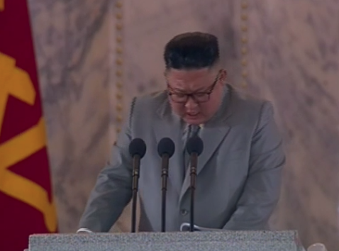 Kim Jong-un delivers speech during North Korea military parade (KCNA TV)
