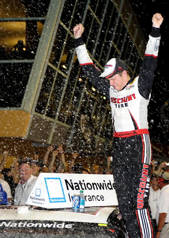 HOMESTEAD, FL - NOVEMBER 19: Brad Keselowski, driver of the #22 Discount Tire Dodge, celebrates after winning the NASCAR Nationwide Series Ford 300 at Homestead-Miami Speedway on November 19, 2011 in Homestead, Florida. (Photo by John Harrelson/Getty Images for NASCAR)