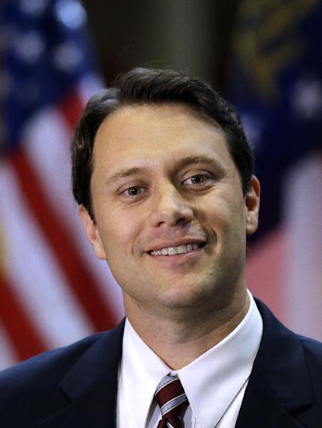 Georgia State Sen. Jason Carter (D-Decatur) announces he has filed paperwork to run for governor during a news conference Thursday, Nov. 7, 2013, in Atlanta. Carter is the grandson of former President Jimmy Carter. (AP Photo/John Bazemore)