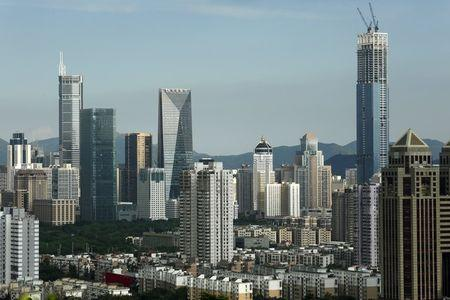 Commercial towers, including the 329-metre-high Hon Kwok City Center (R), which is under construction, are seen in Shenzhen, China August 3, 2015. REUTERS/Bobby Yip