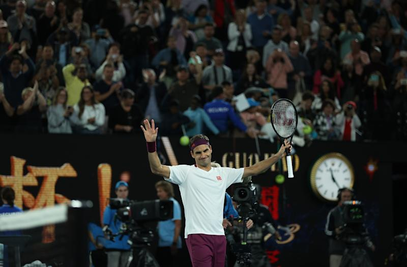 Roger Federer celebrates to the crowd at the 2020 Australian Open.