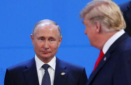 U.S. President Donald Trump and Russia's President Vladimir Putin are seen during the G20 leaders summit in Buenos Aires, Argentina November 30, 2018. REUTERS/Marcos Brindicci