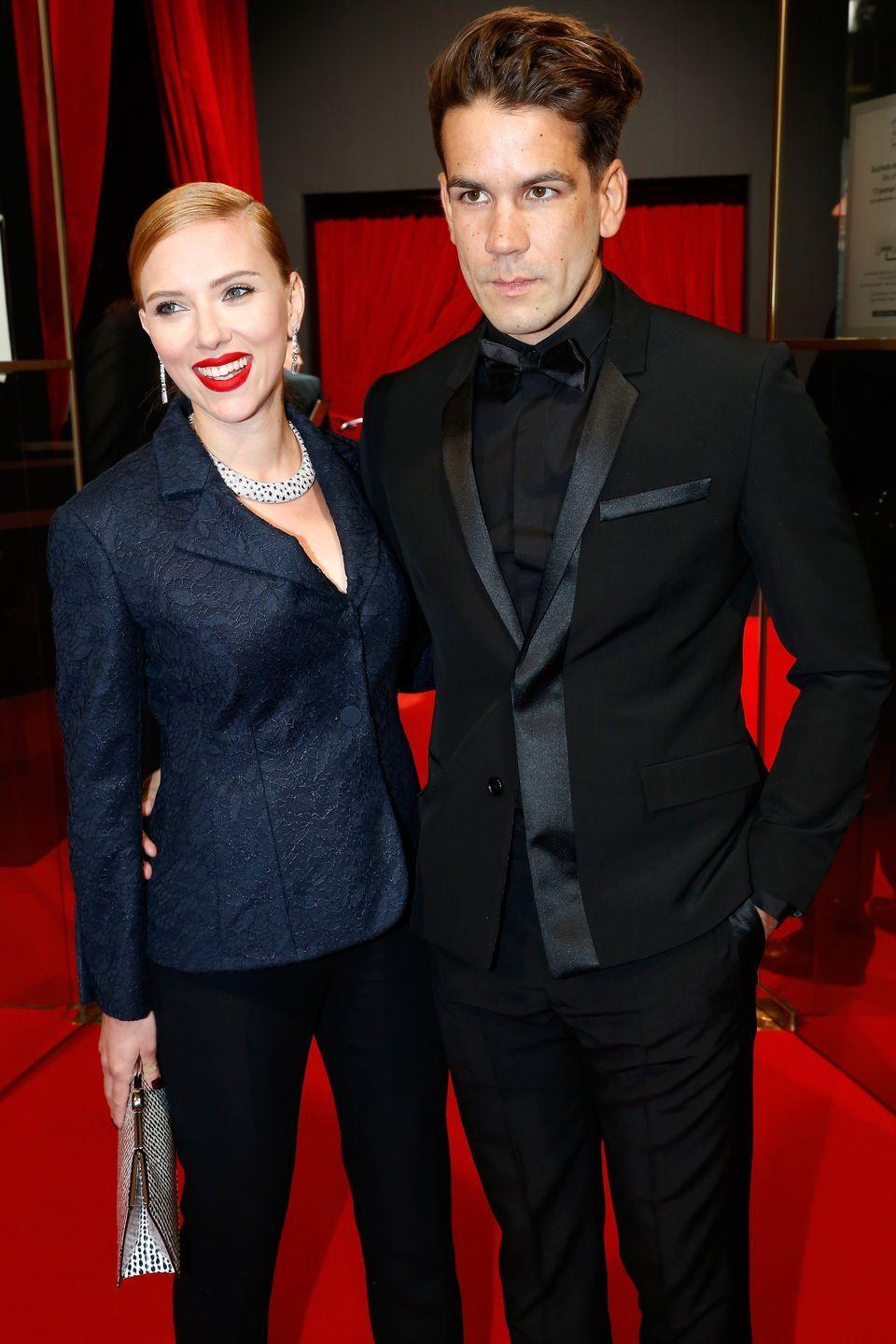 """<p>It seems like Scarlett Johansson is a fan of eloping. Much like her first wedding to Ryan Reynolds, the actress <a href=""""https://people.com/movies/scarlett-johansson-romain-dauriac-split/"""" rel=""""nofollow noopener"""" target=""""_blank"""" data-ylk=""""slk:chose to elope in 2014"""" class=""""link rapid-noclick-resp"""">chose to elope in 2014</a> with French journalist Romain Dauriac. They had recently welcomed their daughter, Rose Dorothy, when they wed in secret.</p>"""