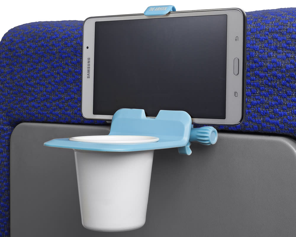 """<p>Cost: $24.95 </p><p>Legroom is practically nonexistent on planes (coach, particularly), and when you use the tray table, you're lucky if you can cross your legs. On your next flight consider <a rel=""""nofollow"""" rel=""""nofollow"""" href=""""https://ec.yimg.com/ec?url=http%3a%2f%2fwww.theairhook.com%2f%26quot%3b%26gt%3bAirhook%26lt%3b%2fa%26gt%3b%2c&t=1511137188&sig=P27oWcPbnrZaLCBT2yVO5Q--~D a small and functional device that holds your cup and electronic device at the same time. The Airhook is easy to use (it clips on to the tray table) and can hold all phones and tablets up to 8.5 inches high. With the hands-free viewing you can skip paying for in-flight entertainment, and load up your iPad or tablet with games and movies for the family.</p>"""