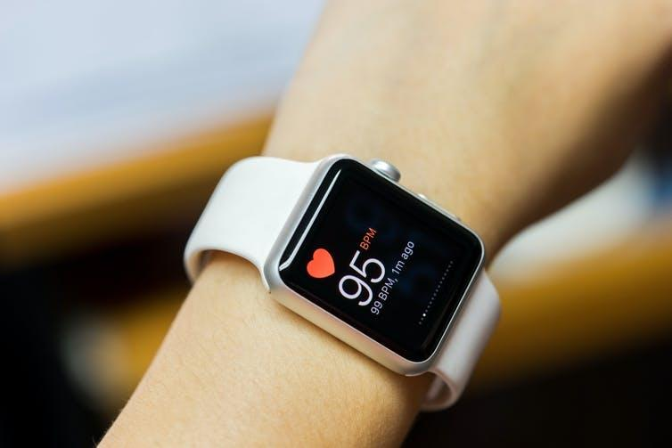 A smart watch with heart rate monitor.