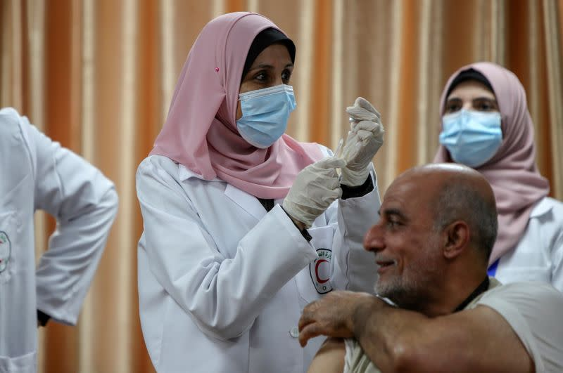 FILE PHOTO: Palestinians begin vaccination in Gaza