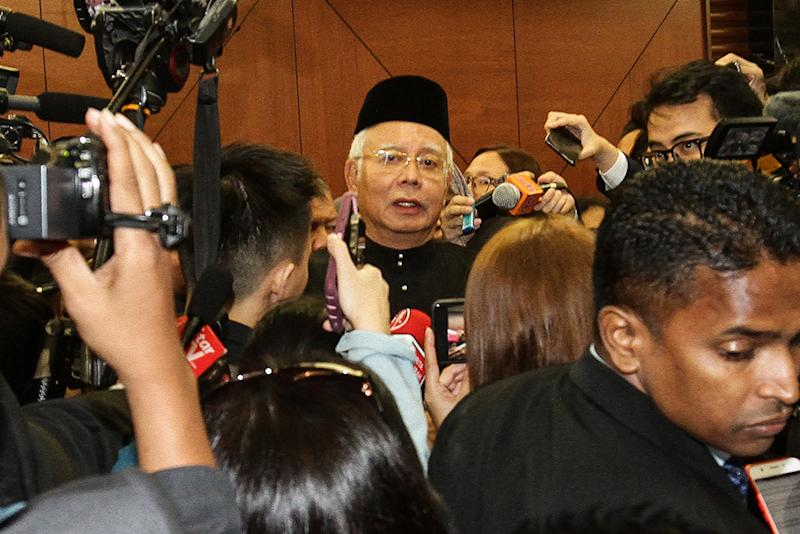 Najib told reporters that he had accepted his fate and stopped dwelling on the past. — Picture by Miera Zulyana