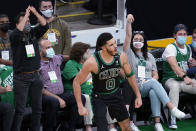 Boston Celtics forward Jayson Tatum (0) and fans celebrate his basket during the second quarter of Game 3 against the Brooklyn Nets in an NBA basketball first-round playoff series Friday, May 28, 2021, in Boston. (AP Photo/Elise Amendola)