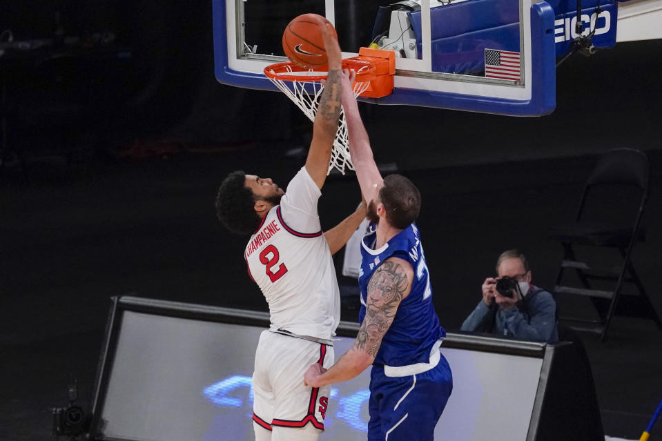 Seton Hall forward Sandro Mamukelashvili (23) goes to the basket against St. John's guard Julian Champagnie (2) during the second half of an NCAA college basketball game in the quarterfinals of the Big East conference tournament, Thursday, March 11, 2021, in New York. (AP Photo/Mary Altaffer)