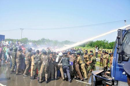 Police clash with demonstrators during a protest against the launching of a Chinese industrial zone by China Merchants Port Holdings Company, in Mirijjawila, Sri Lanka