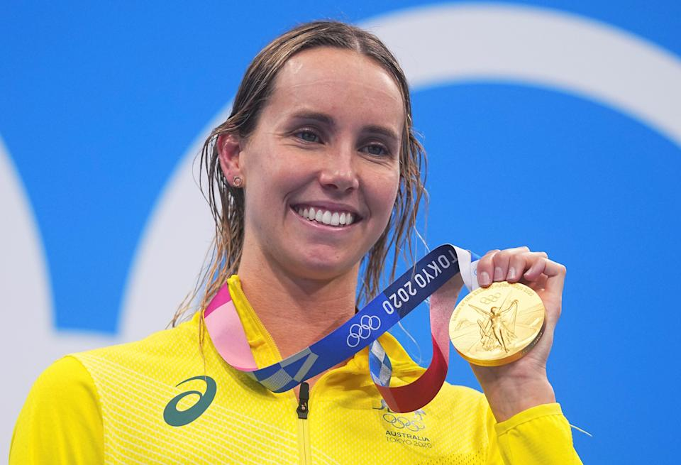 Pictured here, Emma Mckeon poses with one of her gold medals from the Tokyo Games.