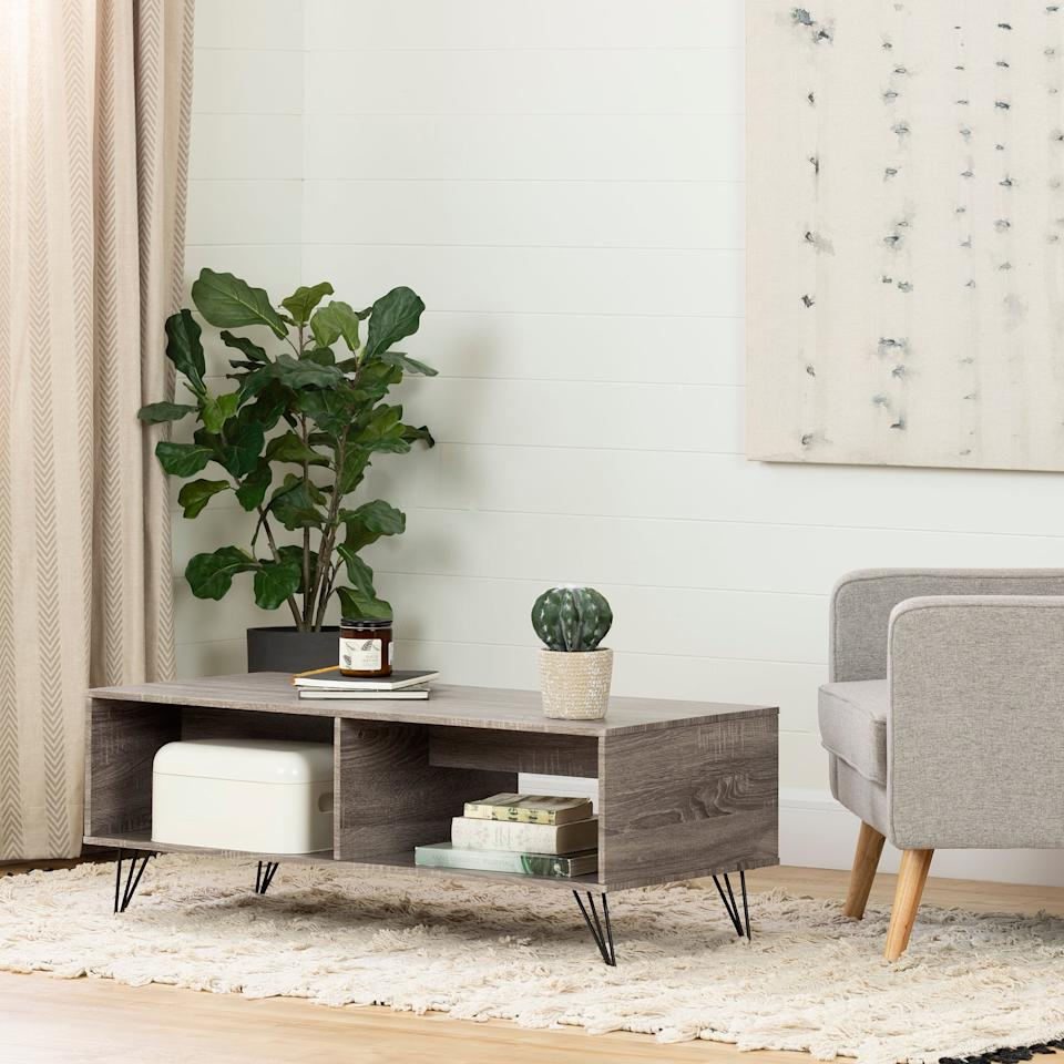 """<p>This <a href=""""https://www.popsugar.com/buy/South-Shore-Evane-Coffee-Table-Storage-432093?p_name=South%20Shore%20Evane%20Coffee%20Table%20With%20Storage&retailer=walmart.com&pid=432093&price=82&evar1=casa%3Aus&evar9=45867877&evar98=https%3A%2F%2Fwww.popsugar.com%2Fhome%2Fphoto-gallery%2F45867877%2Fimage%2F46654227%2FSouth-Shore-Evane-Coffee-Table-With-Storage&list1=shopping%2Chome%20decor%2Cfurniture%2Chome%20shopping&prop13=api&pdata=1"""" rel=""""nofollow"""" data-shoppable-link=""""1"""" target=""""_blank"""" class=""""ga-track"""" data-ga-category=""""Related"""" data-ga-label=""""https://www.walmart.com/ip/South-Shore-Evane-Coffee-Table-with-Storage-Oak-Camel/619274648"""" data-ga-action=""""In-Line Links"""">South Shore Evane Coffee Table With Storage</a> ($82, originally $112) is great for small spaces.</p>"""