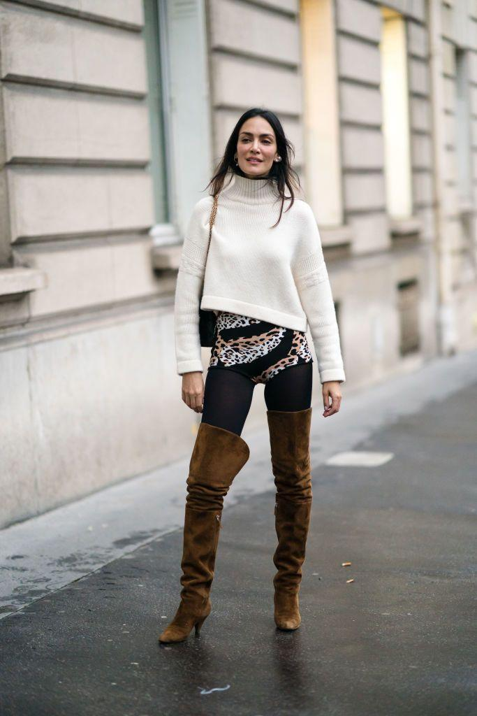 <p>The colder it gets outside, the more you should layer socks and tights under those boots. Wear a cream-colored sweater and add in some animal print for a subtle yet statement-making look. </p>
