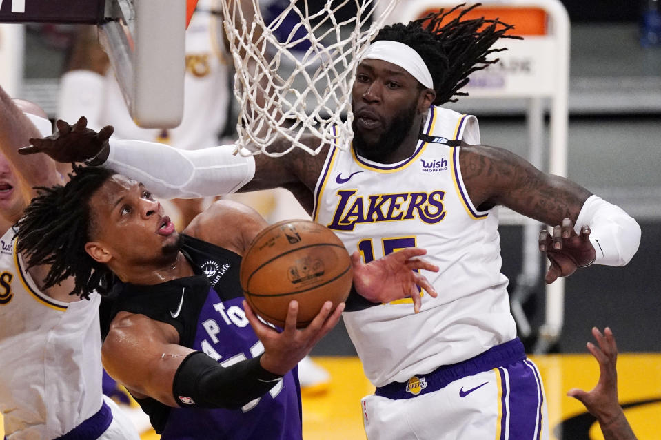 Toronto Raptors forward Freddie Gillespie, left, shoots as Los Angeles Lakers center Montrezl Harrell defends during the second half of an NBA basketball game Sunday, May 2, 2021, in Los Angeles. (AP Photo/Mark J. Terrill)
