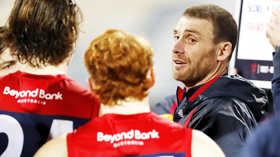 Simon Goodwin, pictured here addressing his players during the Demons' clash with Geelong.