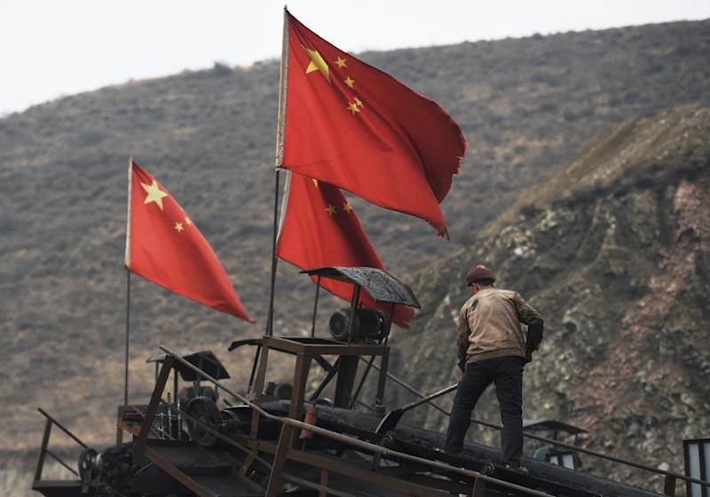 China is suspending all imports of coal from North Korea for the remainder of 2017 (AFP Photo/GREG BAKER)