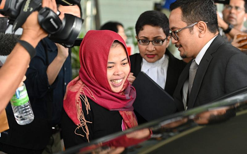 Indonesian national Siti Aisyah (C) smiles while leaving the Shah Alam High Court, outside Kuala Lumpur on Monday - AFP