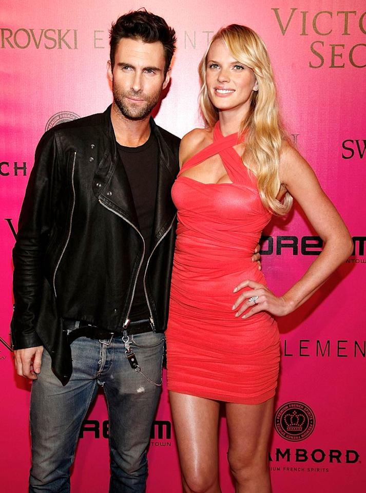 """Maroon 5 frontman Adam Levine had two jobs at the fashion show -- performing his band's hit """"Moves Like Jagger,"""" and escorting his girlfriend, Russian model Anne Vyalitsina, down the catwalk while serenading her. He pulled off both, no problem! (11/9/2011)"""