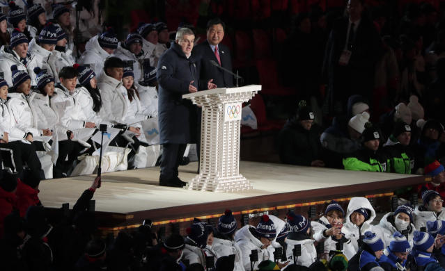 <p>Thomas Bach, President of the International Olympic Committee speaks with Lee Hee-beom, president & CEO of the Pyeongchang Organizing Committee during the opening ceremony of the 2018 Winter Olympics in Pyeongchang, South Korea, Friday, Feb. 9, 2018. (AP Photo/Julie Jacobson) </p>