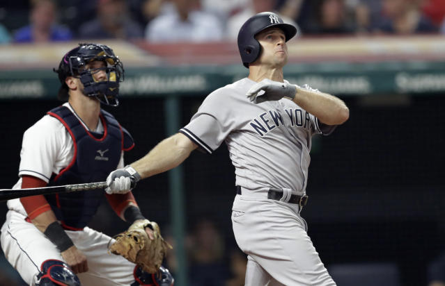 New York Yankees' Brett Gardner watches his solo home run in the ninth inning of the team's baseball game against the Cleveland Indians, Thursday, July 12, 2018, in Cleveland. Indians catcher Yan Gomes is at left. The Yankees won 7-4. (AP Photo/Tony Dejak)