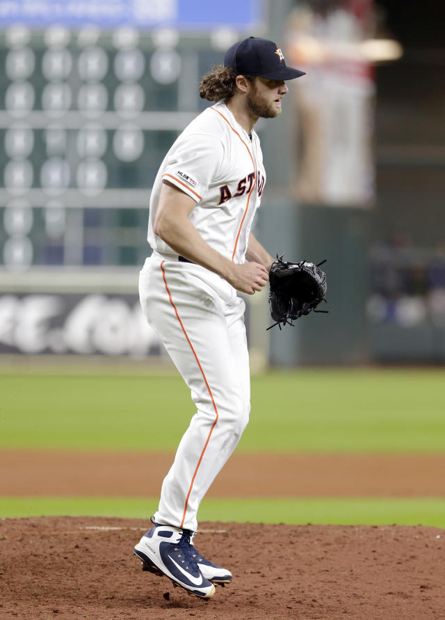 Houston Astros starting pitcher Gerrit Cole reacts to striking out Texas Rangers designated hitter Shin-Soo Choo for his 300th season strikeout during the sixth inning of a baseball game Wednesday, Sept. 18, 2019, in Houston. (AP Photo/Michael Wyke)