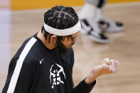 Denver Nuggets center JaVale McGee looks at his championship ring after receiving it prior to their NBA basketball game against the Los Angeles Lakers Monday, May 3, 2021, in Los Angeles. McGee was a member of the Lakers when they won the NBA Championship in 2020. (AP Photo/Mark J. Terrill)