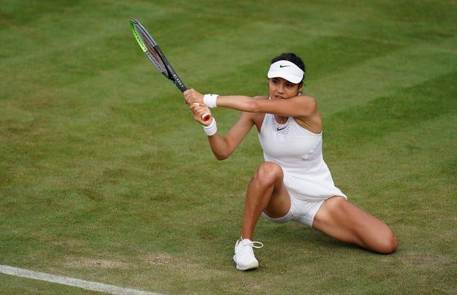 Emma Raducanu plays a backhand from on the grass in her victory over Vitalia Diatchenko