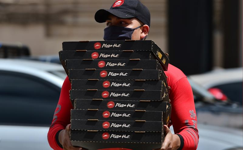 A man delivers pizza in Tegucigalpa, Honduras on July 28, 2020.