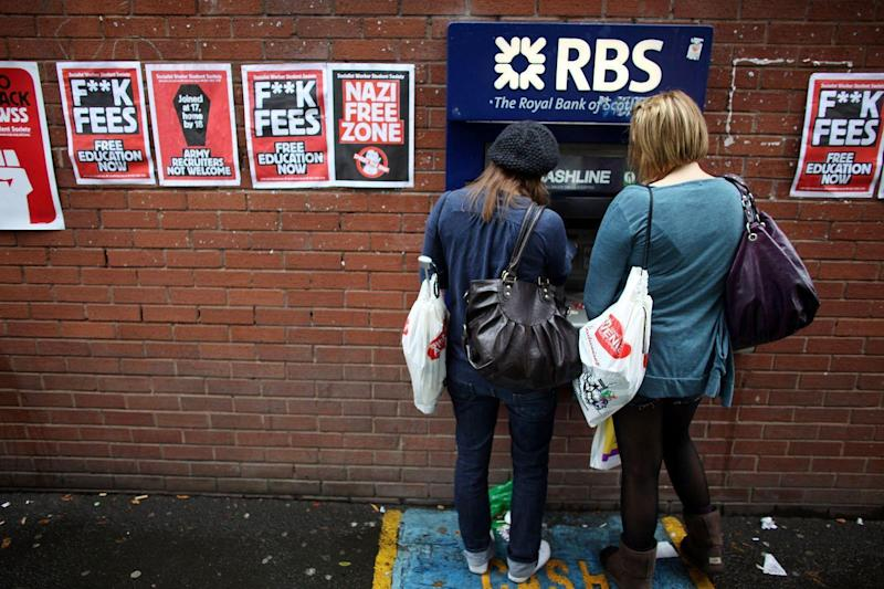 Students arriving for Manchester University's freshers week queue up at a cash machine: Getty