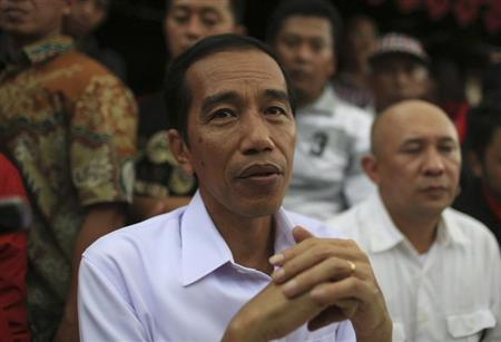 Widodo looks on during PDIP party campaign in Jakarta
