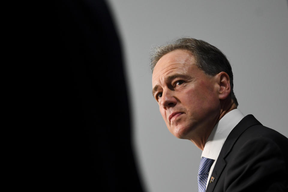 Australian Health Minister Greg Hunt speaks to the media during a press conference at Parliament House in Canberra.